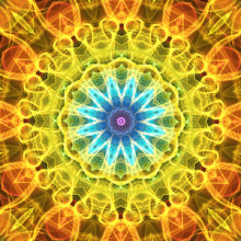 Yellow and orange mandala with a bright blue heart   This mandala was digitally created using various software programs.